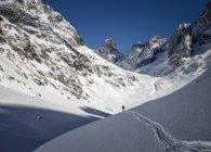 Франції, Ізере, Les де Альп, Vallon du Сель, людина, катання на лижах в горах — стокове фото