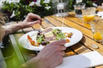 Plate with starter at outdoor restaurant — Stock Photo