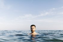 Portrait of young man in the sea — Stock Photo