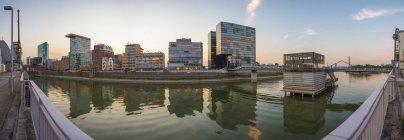 Germany, North Rhine-Westphalia, Dusseldorf, Media Harbor at dusk — Stock Photo