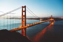 USA, California, San Francisco, Golden Gate Bridge illuminated in the evening — Stock Photo