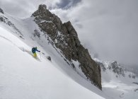 France, Queyras, Nature Park, man off-piste skiing in the mountains — Stock Photo