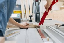 Carpenter working with milling machine — Stock Photo