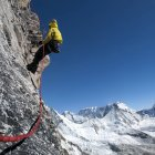 Nepal, Himalaya, Solo Khumbu, Everest region Ama Dablam, mountaineer with rope at rock face — Stock Photo