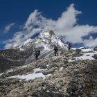 Nepal, Himalaya, Solo Khumbu, Ama Dablam, three Gurkhas trekking — Stock Photo