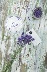 Bunch of fresh lavender, lavender salt in bowl — Stock Photo