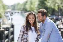 Netherlands, Amsterdam, happy couple at town canal — Stock Photo