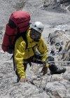 Nepal, Himalaya, Solo Khumbu, Everest region Ama Dablam, mountaineer climbing up rocks — Stock Photo