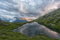France, Mont Blanc, Lake Cheserys, Mont Blanc reflected in the lake in a stormy day at sunset — Stock Photo