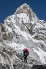 Nepal, Himalaya, Solo Khumbu, Everest region Ama Dablam, mountaineer hiking in the mountains — Stock Photo