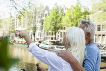Netherlands, Amsterdam, senior couple at town canal — Stock Photo