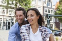 Netherlands, Amsterdam, smiling happy couple outdoors — Stock Photo