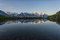 France, Mont Blanc, Lake Cheserys, Mont Blanc reflected in the lake at sunrise — Stock Photo