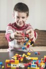 Boy playing with building bricks — Stock Photo