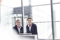 Two stewardesses at departure gate of an airport — Stock Photo