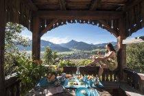 Austria, Salzburg State, Altenmarkt-Zauchense, laid breakfast table on veranda of old farmhouse — Stock Photo