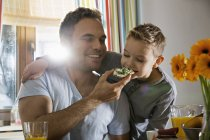 Father and son having breakfast together — Stock Photo