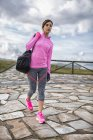 Sportive young woman walking outdoors — Stock Photo