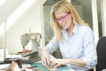 Woman tailoring at the table — Stock Photo