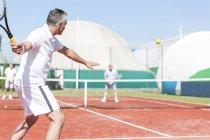Tennis players on tennis court — Stock Photo