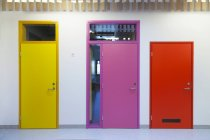 Coloured doors of a newly built kindergarten — Stock Photo