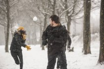 Three friends having a snowball fight — Stock Photo