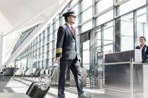 Pilot passing departure gate of an airport — Stock Photo