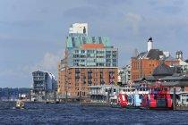 Germany, Hamburg, Altona, River Elbe against buildings — Stock Photo
