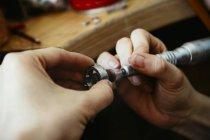 Goldsmith polishing wedding rings in Mokume Gane style — Stock Photo