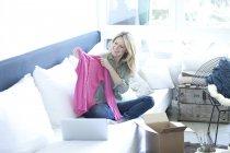 Woman unpacking shopping purchase — Stock Photo