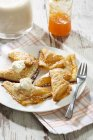 Puff pastry turnovers with apricot jam and whipped cream — Stock Photo