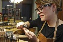 Goldsmith in workshop at work — Stock Photo
