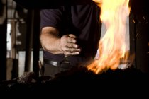 Blacksmith at work, male hand view by the fireplace — Stock Photo