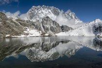 Nepal, Khumbu, Everest region, reflection of Lhotse and Nuptse in lake — Stock Photo