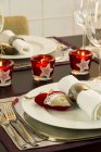 Festive laid dinner table decorated with candles — Stock Photo