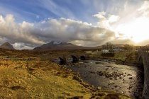 UK, Scotland, Isle of Skye, bridge over water under clouds — Stock Photo