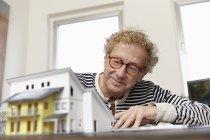 Senior man planning residential building — Stock Photo