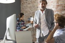 Two businessmen in modern office talking — Stock Photo