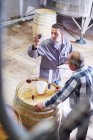 Wine makers testing wine blend in wine store — Stock Photo