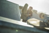 Teenage girls in skatepark talking — Stock Photo