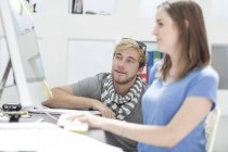 Creative office people discussing work on a computer — Stock Photo