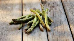 Green asparagus in heap — Stock Photo