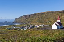 Iceland, Vik, view to village and church against water  during daytime — Stock Photo