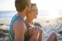Young couple sharing a moment on the beach — Stock Photo