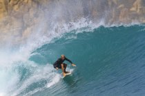 Indonesia, Lombok Island, surfing man a wave — Stock Photo