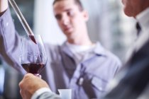 Wine makers testing wine blend — Stock Photo