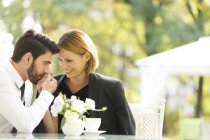 Affectionate couple at outdoor cafe — Stock Photo