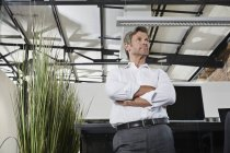 Businessman thinking in office — Stock Photo