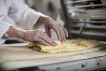 Femal baker preparing dough — Stock Photo