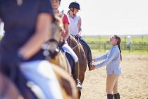 Coach and girls on horses on riding ring — Stock Photo